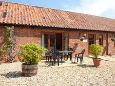 This single-storey cottage in the Norfolk village of Wood Norton sleeps six people in three bedrooms. Norfolk Cottages, Holiday Cottages To Rent, Fire Kids, Great Yarmouth, Log Fires, Self Catering Cottages, Ground Floor, Trip Advisor, Patio