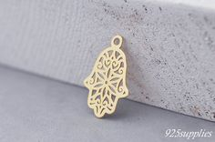 925 Sterling Silver Hamsa plated 24 carat gold, Hamsa Pendant, Silver Hamsa, Small Hamsa, jewelery making, craft tools, semi-finished jewelery, Hamsa, Hand of Fatima, Hand of Buddha  Plated - The product is covered with 24-carat gold. The product is covered with two layers of gold, and the final backing layer, with the result that the device is more rugged.  > Material: Sterling Silver 925 plated with 24 carat gold > Size: 11,8mmx17,5 (0.46x0.69 inch) A = 11,8mm (0.46inch) B = 17,8mm…
