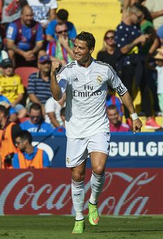 Cristiano Ronaldo of Real Madrid celebrates after scoring during the La Liga match between Levante UD and Real Madrid at Ciutat de Valencia on October 18, 2014 in Valencia, Spain.