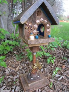 Garden art fairy house, gives me the idea to use bobbins around the door, chairs etc.
