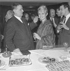 French actress Brigitte Bardot attends a gala evening for the Societe des Auteurs, Compositeurs, et Editeurs de Musique (SACEM). She is joined by SACEM's director, Georges Auric (L).