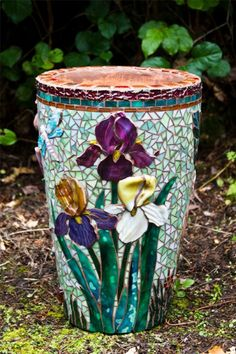 Iris love growing them... pretty mosaic on this pot! :)