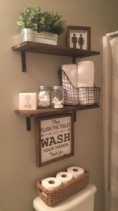 Bathroom shelving. wood shelves and toilet paper in a basket.. Farmhouse bathroom remodel ideas #bathroomremodel by gayle