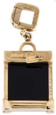 18K yellow gold Louis Vuitton Steamer Bag Charm with black onyx and hinged clip clasp closure.