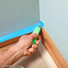 It's easy to get a perfect fit on inside corners with this simple technique.Start by running the first piece of tape up the wall, making it a little long. Press the tape down into the corner with a putty knife. Then cut along the crease with a sharp utility knife and remove the cutoff piece. Now you don't have to be so careful with the next piece.