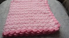 This is a crochet pattern to make a small and medium light blanket for baby s pram or carseat .Very elegant when done.The blanket small and