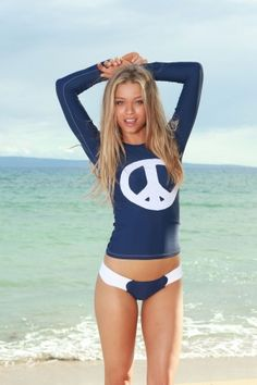 with rash guards as cute as this maybe i will start surfing...