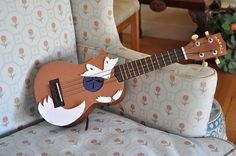 cute DIY projects. fox decorated guitar