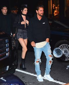 She forgot her bra: The beautiful brunette wore her black denim shorts the night before, plus a very revealing blouse that plunged to her navel, as she went for dinner with half-sister Kourtney's ex Scott Disick