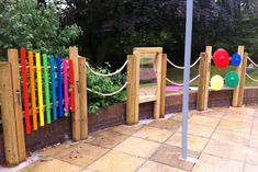 An old tatty patio area, take some false grass, a sail shade, some rope fencing and outdoors activities like chimes and mirror and here you have it. A great sensory garden area for the residents to enjoy.