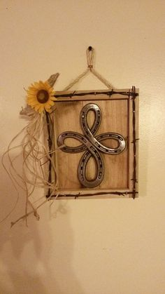Infinity Cross made from horseshoes