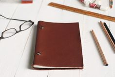 Or turn a piece of leather into a sketchbook.