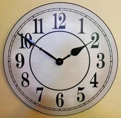 The Simply White Clock can be customized with a name or change the Arabic numbers to Roman numerals. Also add a Family Name, Business or whatever suits your fancy. http://www.clocksaroundtheworld.com/medium-clocks.html