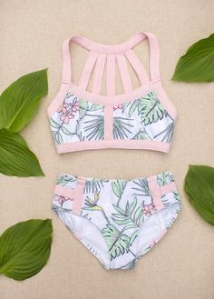 Featuring a beautiful strapped back detail and a lovely tropical inspired print, this swimsuit is the perfect go-to summer piece!