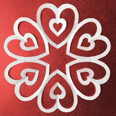 Heart Drop paper snowflake pattern - very easy to cut out! Part of 10 Valentine's Day paper snowflake patterns. Download, print, and cut at home! #valentine #valentinesday #hearts #snowflake #papersnowflake #snowflakes #papersnowflakes #DIY #printable