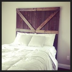 Buy a fence from Home Depot, stain it, and add Z shapes for a barn door headboard!