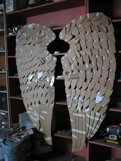 Crafty Butt: PB knock-off angel wings cardboard covered with paper mache… great idea!