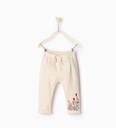 Trousers with embroidered hem