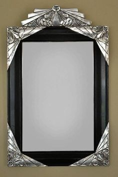 Stunning carved 1930s French mirror with Ebony black and silver leaf