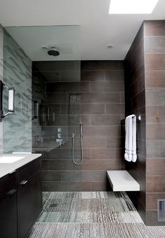 Love this set up for the shower, the bench, and the gray wall