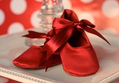 red ballet shoes for an infant