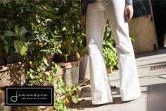 Pantaloni zampa bianchi