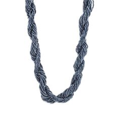 You'll be ready for year round island living wearing Isla. This bold, shimmering blue ocean-like twist of beads is a statement-maker. Isla's deep blues will pair beautifully with gold hoops. This knockout will elevate everything from a sun dress to a simple white button down. Find it on Splendor Designs