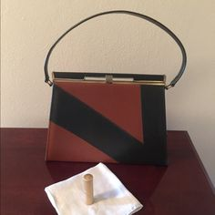 Mad Men Style Vintage Two Tone purse Air Step vintage purse in great condition.  Tan and olive green in front of purse and solid olive green back. Gold top clasp, interior slip pocket and interior zippered pocket Air Step Bags Clutches & Wristlets