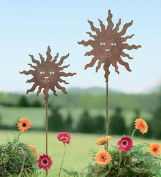 """Set Of 2 Rusted-Finish Metal Smiling Sun Garden Stakes by Plow & Hearth. $24.99. Large smiling sun stake is 48""""H, small is 41""""H. Smiling sun metal garden stakes, set of 2. Crafted from durable metal with an attractive rusted. Use sun stakes together or individually-perfect for bed, border, yard and g. Classic sun garden décor with detailed faces an. No matter the weather, our Set Of 2 Rusted-Finish Metal Smiling Sun Garden Stakes will add cheerful whimsy to your yard..."""
