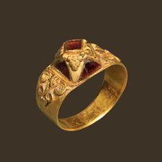 A gold ring with a pyramid bezel, inlaid with a garnet , Merovingian, ca 6th-7th century A.D.