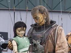 Little Girl Giant and Uncle from the Sea Odyssey Spectacular fast asleep in the Kings Dock, Liverpool.