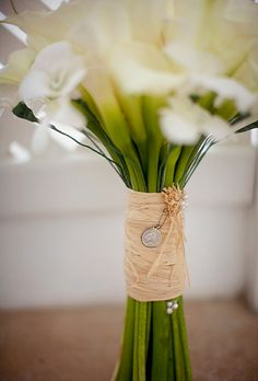 Brides.com: . The traditional bouquet came with a twist: It was tied with raffia and pinned with pearls.