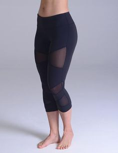 The perfect unity of fashion and athletic functionality wrapped up into a pair of workout crops. Step your fitness fashion game up a notch with these strategically sliced, sheer mesh inlayed crops.