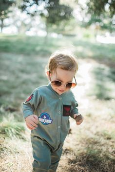 Oh my. Not only is this cute, its personalized. We will add your childs name to the black and red name patch! We hand dye this flight suit and make each of these cute little patches ourself. This flight suit is relatively light weight (add cotton weight info here), layering up for colder climates and staying comfy for the warmer ones!  Please note name personalization at checkout.