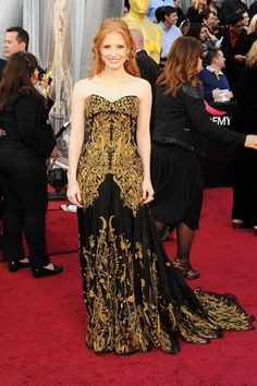 Jessica Chastain in Alexander McQueen, featuring intricate gold embroidery on the bodice and the skirt