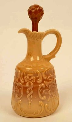 """Greentown/ McKee Chocolate glass wild rose with bow knot cruet. Measures 7.5"""" H with stopper.  Made by the Indiana Tumbler and Goblet Company of Greentown, Indiana, from 1900 to 1903."""