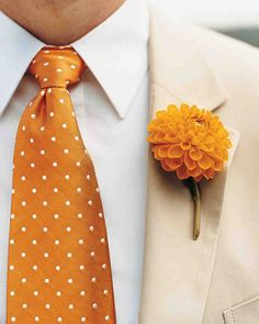 Dahlia boutonniere on a tan suit with a polka dot tie. A Vibrant Casual Outdoor Wedding in Tennessee
