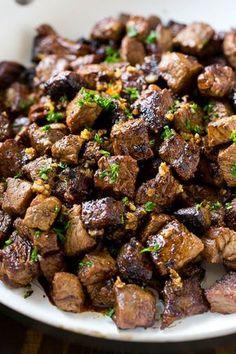 Bites of sirloin steak in a garlic sauce.