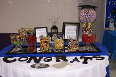 "Another thing I did for son's senior grad party- ""candy Bar"" placed on a mirror with painted wooden letters and ribbon through the vases of candy saying class of 2013- big hit! Along with the graduation candy man tree- Jo Ann DeWitt Wright"