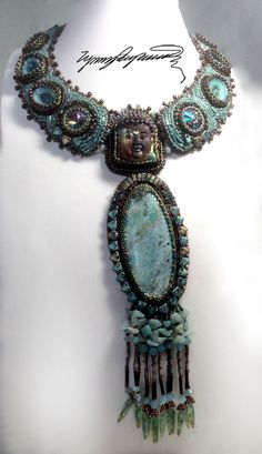 https://www.etsy.com/shop/LynnParpard?ref=pr_shop_more Buda in the MIST made with outanding Limpet shells a natural turqoise blue  S T U N N I N G Piece Could be in your Collection !