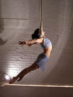 Neck hang on a static trapeze.