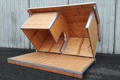 You love your dog but you hate when they ruffle their fur in your bed at night. Rather than kicking them away at night, it is better to design a dog house idea and turn it into a proper house for your beloved doggy. Outside Dog Houses, Outside Dogs, Cool Dog Houses, Outdoor Dog Houses, Pallet Dog House, Dog House Plans, Cat House Diy, House Dog, Luxury Dog House