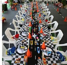 Checkered table cloth, black runner with tape for road, mini orange cones from sports store used for football/sports training. Cars 2 birthday theme