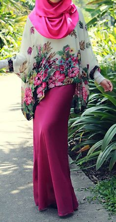 I love this style - wear a loose top over a dress to keep it fashionable but modest.