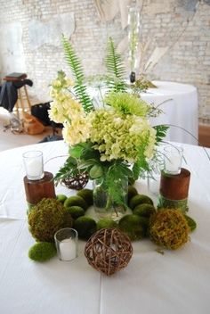 rustic centerpiece queen anns lace, green hydrangea, stock, green fujis, moss and grapevine balls