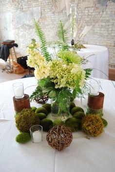 rustic centerpiece queen anns lace, green hydrangea, stock, green fujis, moss and grapevine balls