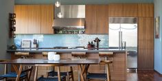 This Texas home's renovation resulted in a kitchen complete with a blue-tiled backsplash.