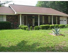 421 Walda Dr, Biloxi - Great brick home in lovely neighborhood; Features 3 BR 2 Bath, Family room with Fireplace, Eat In kitchen; cozy Sun room; Large back yard with Custom Deck; Workshop.  House conveniently located.