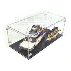 Quick idea to display toys in acrylic boxes on a shelf. Maybe in the corner of the upstairs living room.