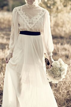 I love this vintage dress. Classy and Elegant. Minus the black sash. Such beautiful lace.